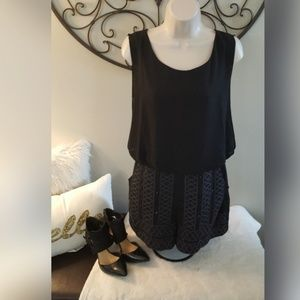 GB romper with pockets and embellished front.